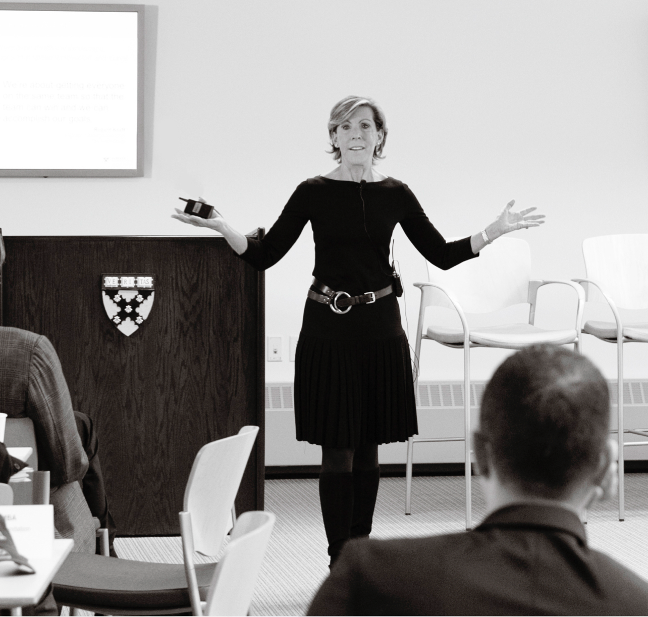 Kathy leads a presentation at Harvard Business School